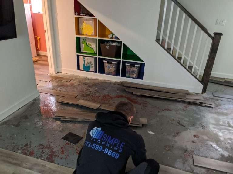 water damage vinyl floor removal